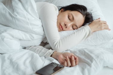 woman in white sleeping in bed