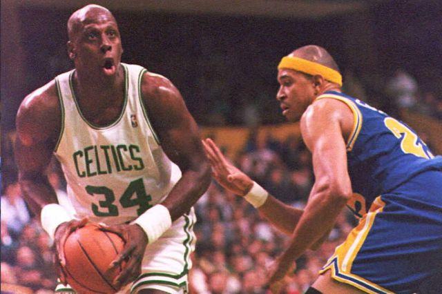 Xavier McDaniel of the Boston Celtics drives to the basket past Chris Gatling of the Golden State Warriors.