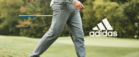 Mens Golf Trousers for less at SportsDirect com Male golfer walking wearing grey adidas golf trousers