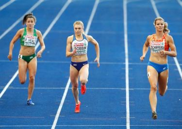 Sports For Champions' very own Beth Dobbins running alongside two other female sprinters.