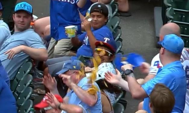 Rangers Fan Dumps Nachos on Another Fan Catching a Foul Ball in His Helmet Nachos