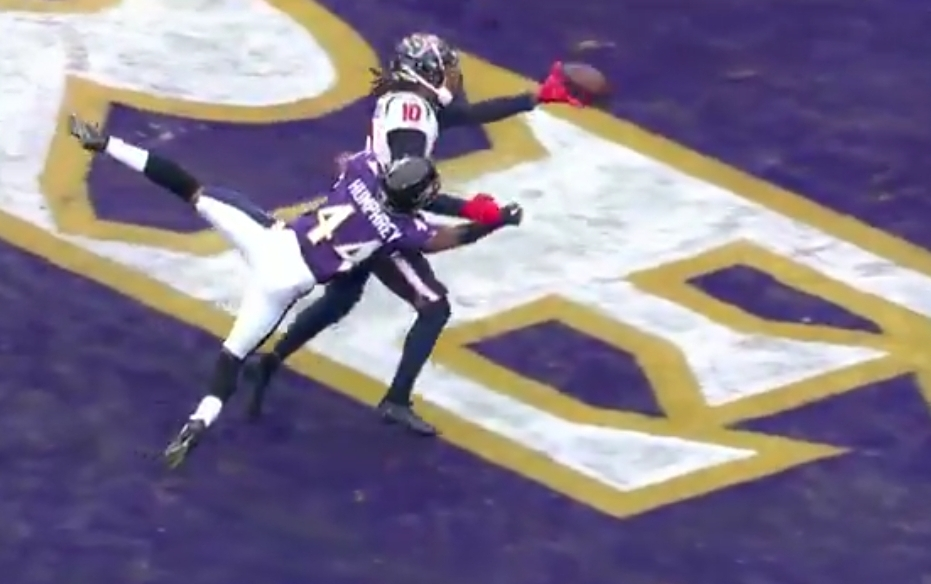 According to Officials Grabbing a Receiver's Jersey and Tackling Them is Not Pass Interference
