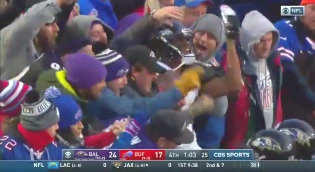 Marcus Peters Seen Shotgunning a Beer in the Stands With Fans at the End of Win Over the Bills