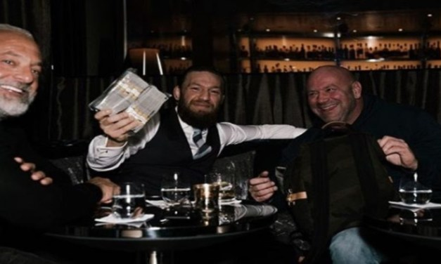 Conor McGregor Laughs as Dana White Hands him $50K IN CASH over Whiskies to Celebrate Win