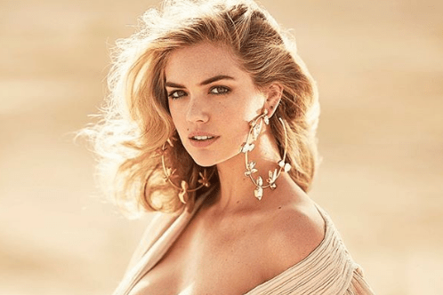 Maxim Shares a Picture of Kate Upton Spilling Out of Her Top