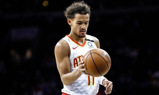Hawks' Young jaws at Allen after feet get tangled