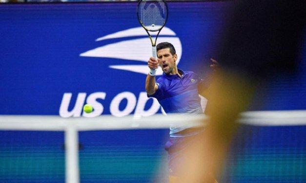 Djokovic drops 1st set, then rallies into quarters