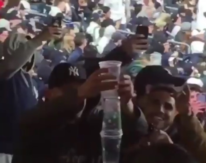 Yankees Fans Pile Garbage On Passed Out Guy's Head