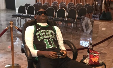 Shooting Victim Propped Up in a Kyrie Irving Jersey Playing NBA 2K at His Wake