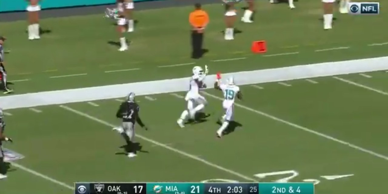 Dolphins Receivers High Five Each Other Mid-Play