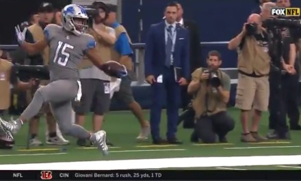 Lions Receiver Golden Tate Highsteps in Dallas on His Way to a Touchdown