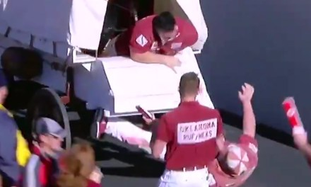 Sooners Cheerleader Hilariously Falls Out of the Back of Sooners Schooner Wagon