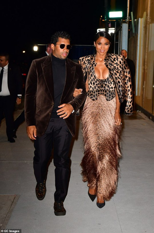 10964794-6806997-Exit_in_style_Russell_and_Ciara_left_the_soiree_in_style-a-55_1552552624762_MTYyNjQxOTg0MjM2ODIzNTky