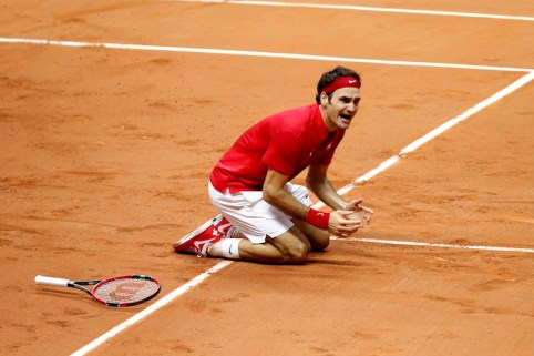 Switzerland's Roger Federer reacts after he defeated France's Richard Gasquet during their Davis Cup final singles tennis match at the Pierre-Mauroy stadium in Villeneuve d'Ascq