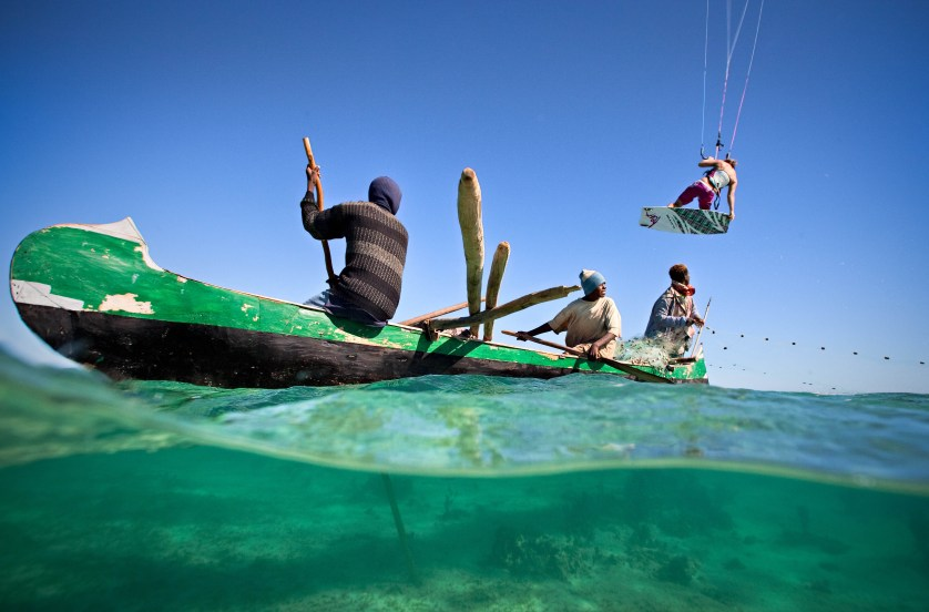 Kristin Boese jumps locals in Madagascar by Jody MacDonald