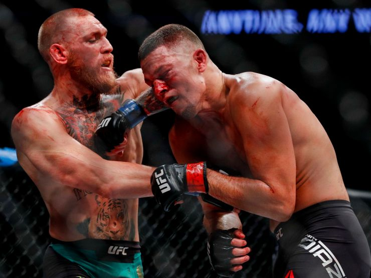 Conor McGregor throwing an elbow at Nate Diaz