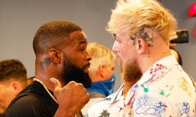 Jake Paul and Tyron Wodley square off at a media event