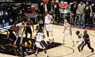 Lakers and suns jumping for ball