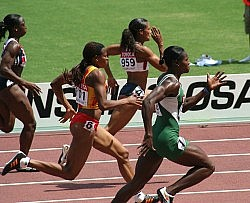 US athlete Torri Edwards (no. 959) running 100 meters during her first round heat. Also pictured: Vida Anim (no. 511), Oludamola Osayomi (right) and Jeanette Kwakye (left). Photo by Eckhard Pecher