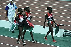 Three Kenyan athletes after finishing second, third and fourth in the women*s 5000 metres: Sylvia Jebiwott Kibet, Priscah Jepleting Cherono, Vivian Cheruiyot. Photo by Eckhard Pecher