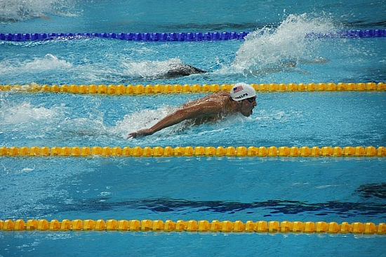 Michael Phelps in the 100m butterfly. Photo by Flickr user Keso S
