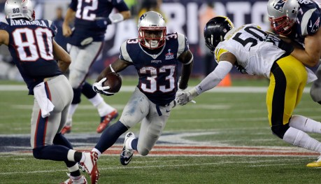 New England Patriots running back Dion Lewis (33) runs past Pittsburgh Steelers linebacker Ryan Shazier (50) in the second half of an NFL football game, Thursday, Sept. 10, 2015, in Foxborough, Mass. (AP Photo/Stephan Savoia)