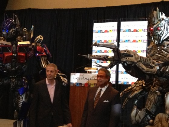 Thomas See, vice-president, sales & marketing, Universal Studios Hollywood (left) and Ernest Wooden Jr., president & CEO, Los Angeles Tourism & Convention Board (right) pose with Transformers.