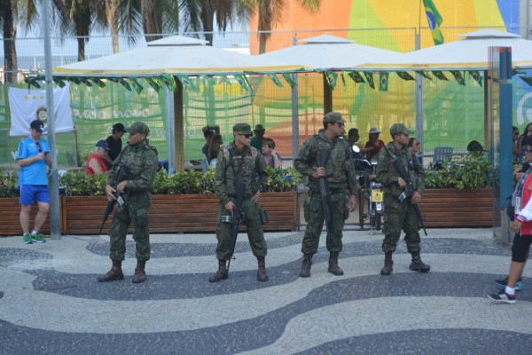 Soldiers stand guard outside the beach volleyball venue in Copacabana.