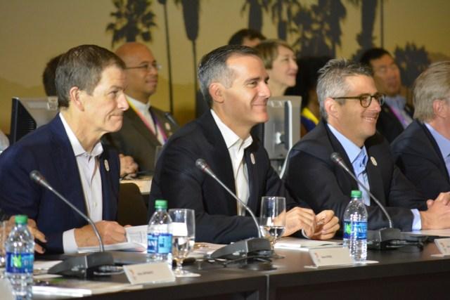 l to r, LA2024 CEO Gene Sykes, LA Mayor Eric Garrett and LA2024 Chairman Casey Wasserman