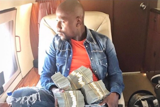 Floyd Mayweather says he's officially 'billionaire' (photos)
