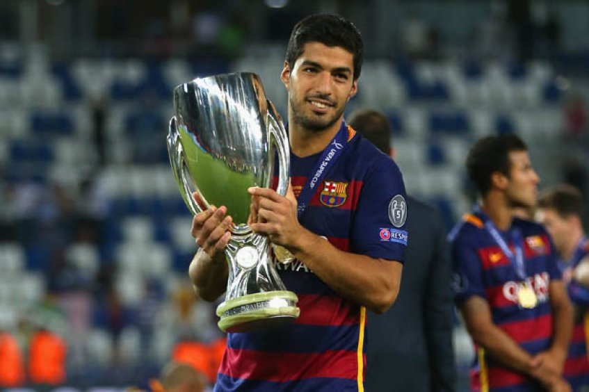 Luis Suarez with trophies