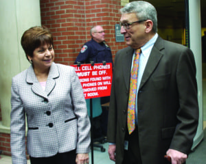 Colonie Town Supervisor Paula Mahan would like nothing more than to see the now empty Skylane Motel demolished, and has been waiting for nearly a year to see it happen. Here she is pictured walking out of Colonie Town Court with town attorney Michael Magigulli last March, after an agreement was settled to have both Skylane and Blu-Bell motels demolished. Spotlight file photo