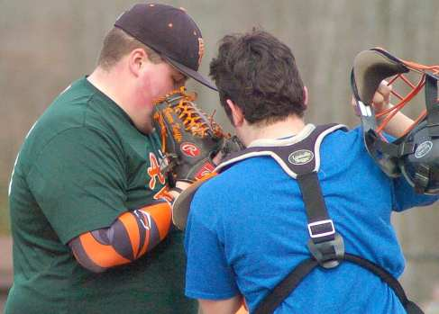 Bethlehem baseball pitcher Trevor Kniffen, left, talks strategy with his catcher during a practice Wednesday, March 16. Rob Jonas/Spotlight