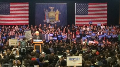 Sanders addresses thousands of enthusiastic supporters at Washington Armory in Albany.
