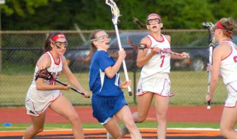 Shaker's Maeve Lennon weaves her way through Guilderland's triple team. Rob Jonas/Spotlight