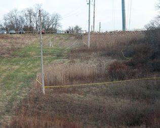 Police tape along the hillside behind Hoffman Car Wash (Photo by Jim Franco/Spotlight News)