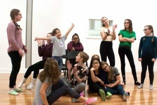 The cast of 'Annie' is all smiles during the Park Playhouse's rehersal of the Tony Award-winning musical. It is set to run from Dec. 17 to 22. Photos by Diego Cagara/ The Spot 518