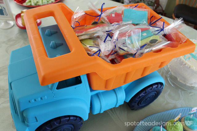 Transportation Themed Baby Shower: Sugar Cookie Favors in a toy truck | spotofteadesigns.com