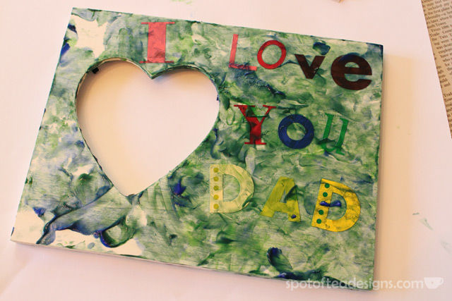 Father's Day Sticker Resist Frame: 9 month old baby project. Apply stickers, let them finger paint, then peel to reveal message!   spotofteadesigns