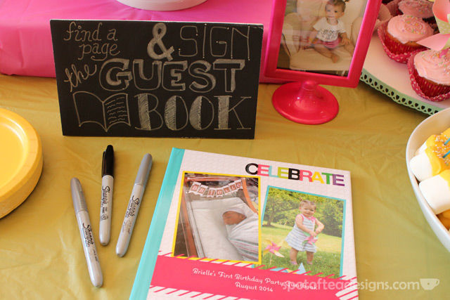 Pinwheel first birthday party: @Shutterfly photo book with blown up photos on each page to serve as guest book #birthdayparty | spotofteadesigns.com