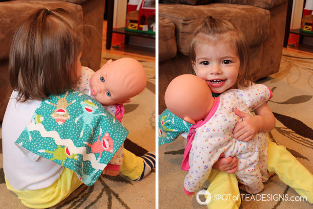 Handmade baby burp cloths as demonstrated by toddler baby doll play | spotofteadesigns.com