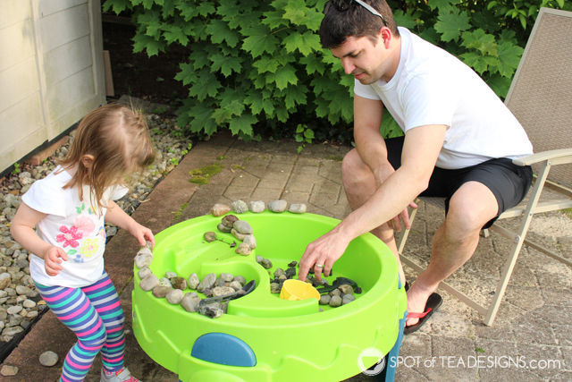 3 Fun Outdoor Activities for Toddlers this summer - Rock play in water table. #ad #TopYourSummer #SoHoppinGood  spotofteadesigns.com