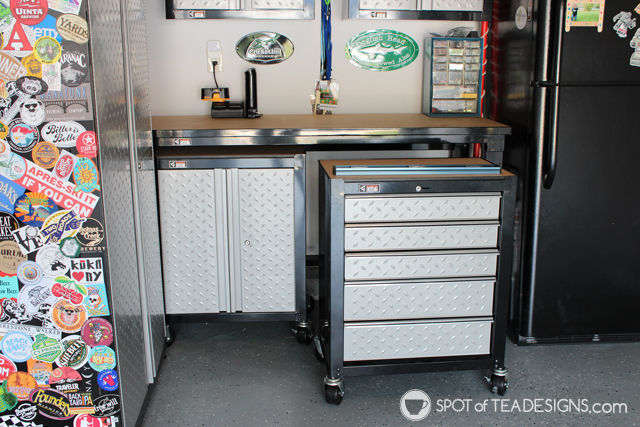 Take a tour of a clean and organized garage complete with resources on products used. Gladiator cabinets pull out for extra surface working space. #organization #garage #mancave | spotofteadesigns.com