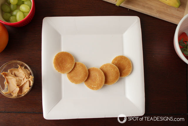 Caterpillar and butterfly breakfast with @Eggo waffles and pancakes #EggoMyWay #foodart #toddlerfood #ad #shop #cbias | spotofteadesigns.com