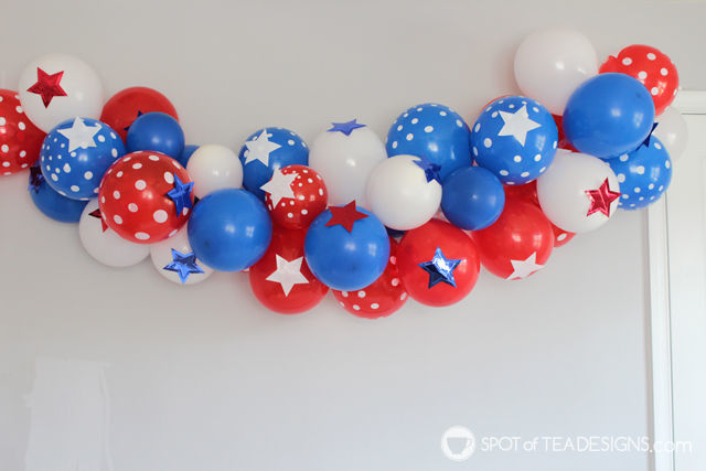 Patriotic Toddler Photoshoot showcasing a balloon arch | spotofteadesigns.com