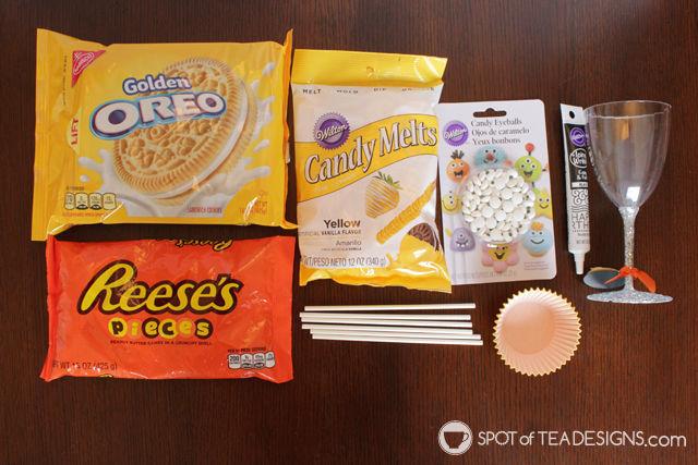Halloween Emoji Cupcake Dessert - cookie pop + cupcake + candy = a delicious dessert for a Halloween party!   spotofteadesigns.com