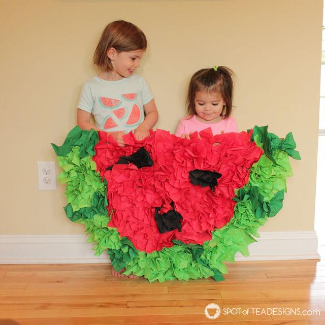 Watermelon paper napkin party backdrop tutorial - cheap party decor! | spotofteadesigns.com
