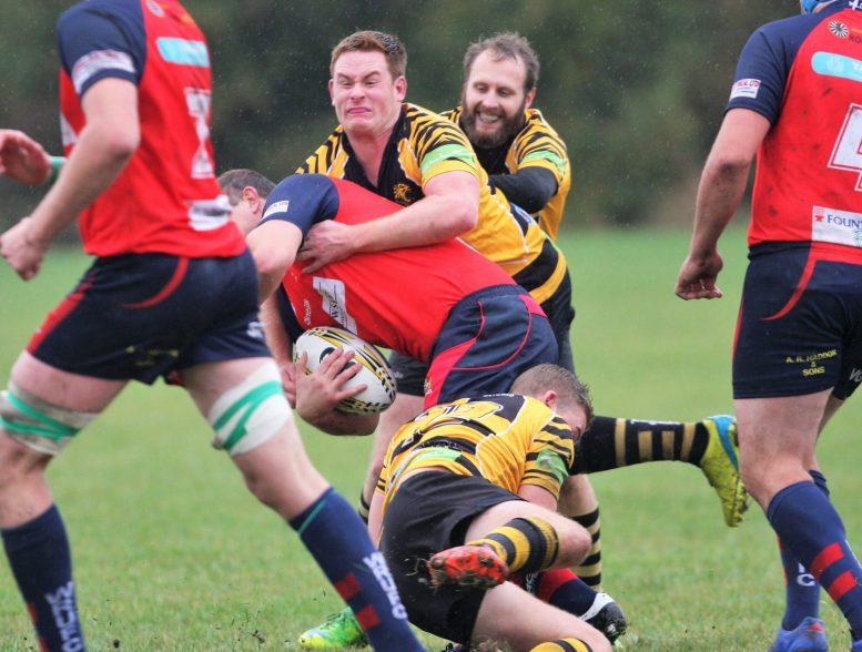 Luke Cornwell applies pressure to hold up Wisbech