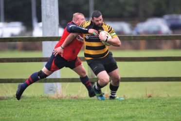 Man Of The Match Jacob Muncey holds off a last ditch tackle to score
