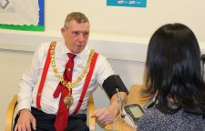 The Mayor learns about the benefits of the service as he has his blood pressure taken at an evening GP appointment